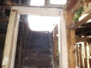 Picture from burned out home of Cindy and Martin. To the right is a room that has been dismantled to the studs, prepping for take down.
